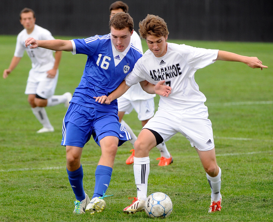 . Grandview defender Bryan Tanner (16) battled for the ball with Arapahoe forward Jack Ryan (7) in the first half. The Grandview High School boy\'s soccer team defeated Arapahoe 2-0 Thursday evening, September 19, 2013.  Photo By Karl Gehring/The Denver Post