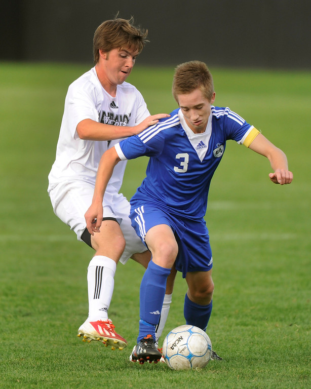 . Grandview midfielder Jake Smith (3) worked against Arapahoe\'s Jack Ryan (7) in the first half. The Grandview High School boy\'s soccer team defeated Arapahoe 2-0 Thursday evening, September 19, 2013.  Photo By Karl Gehring/The Denver Post