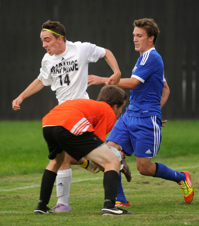 . Arapahoe goalkeeper Dan Scott scooped up the ball as defender Duncan Malone and Grandview midfielder Adam Riasati (4) raced in. The Grandview High School boy\'s soccer team defeated Arapahoe 2-0 Thursday evening, September 19, 2013.  Photo By Karl Gehring/The Denver Post