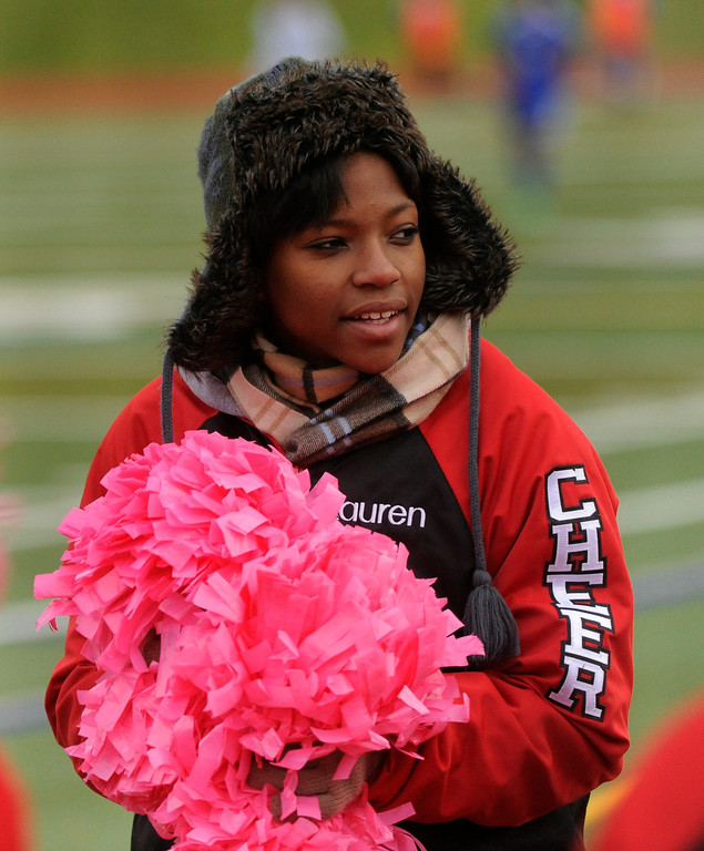 . AURORA, CO. - OCTOBER 15: Raiders cheerleaders came prepared for the cold Tuesday night. The Rangeview High School boy\'s soccer team remained undefeated this season with a 3-0 win over Hinkley Tuesday evening, October 15, 2013. Photo By Karl Gehring/The Denver Post