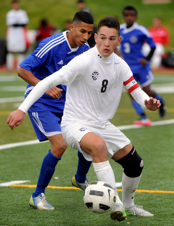 . AURORA, CO. - OCTOBER 15: Rangeview midfielder Troy Hudson (8) scored the first two goals for the Raiders. The Rangeview High School boy\'s soccer team remained undefeated this season with a 3-0 win over Hinkley Tuesday evening, October 15, 2013. Photo By Karl Gehring/The Denver Post