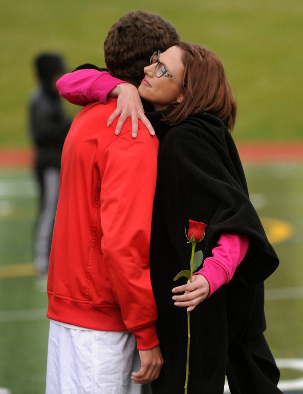. AURORA, CO. - OCTOBER 15: Raiders forward Kyler Iacino got a hug from his mom Jennifer as the seniors were honored before the game. The Rangeview High School boy\'s soccer team remained undefeated this season with a 3-0 win over Hinkley Tuesday evening, October 15, 2013. Photo By Karl Gehring/The Denver Post