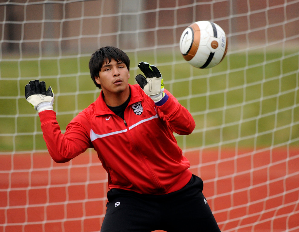. AURORA, CO. - OCTOBER 15: Raiders goalkeeper Edward Zuniga warmed up before the game. The Rangeview High School boy\'s soccer team remained undefeated this season with a 3-0 win over Hinkley Tuesday evening, October 15, 2013. Photo By Karl Gehring/The Denver Post