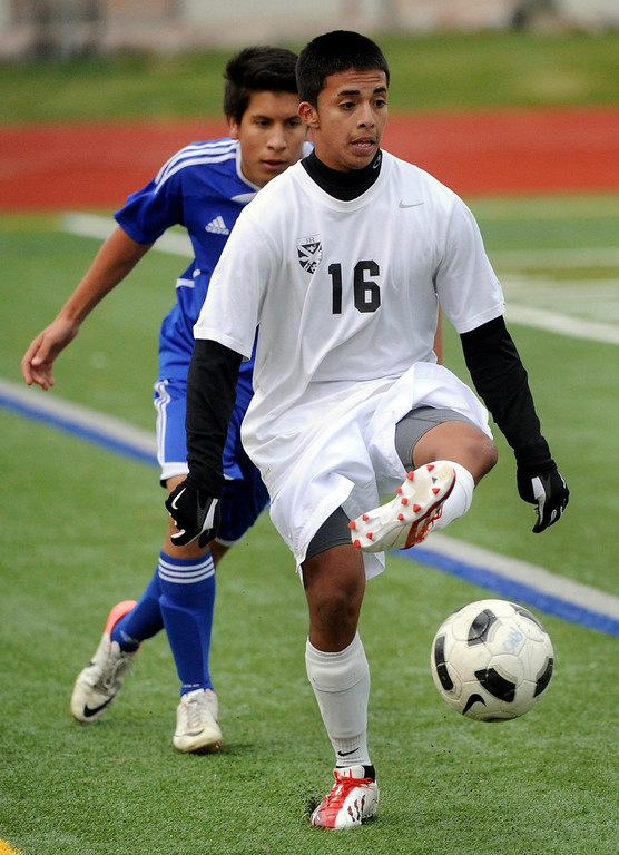 . AURORA, CO. - OCTOBER 15: Rangeview forward Jack Ramirez (16) controlled the ball in the first half. The Rangeview High School boy\'s soccer team remained undefeated this season with a 3-0 win over Hinkley Tuesday evening, October 15, 2013. Photo By Karl Gehring/The Denver Post