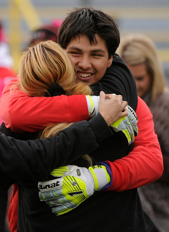 . AURORA, CO. - OCTOBER 15: Rangeview senior goalkeeper Edward Zuniga embraced his mother before the game. The Rangeview High School boy\'s soccer team remained undefeated this season with a 3-0 win over Hinkley Tuesday evening, October 15, 2013. Photo By Karl Gehring/The Denver Post