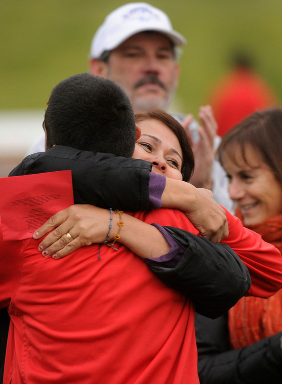 . AURORA, CO. - OCTOBER 15: Rosa Martinez hugged her son defenseman Eddie Martinez as the seniors were honored before the game. The Rangeview High School boy\'s soccer team remained undefeated this season with a 3-0 win over Hinkley Tuesday evening, October 15, 2013. Photo By Karl Gehring/The Denver Post