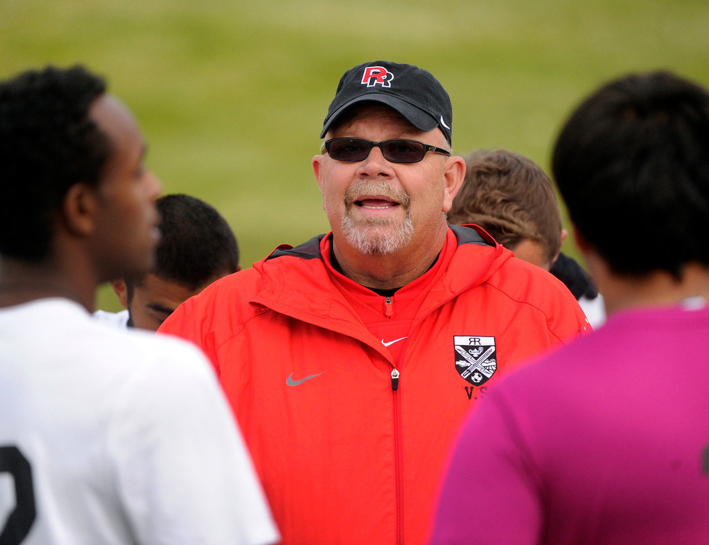 . AURORA, CO. - OCTOBER 15: Raiders coach Vic Strouse talked to the team before the game. The Rangeview High School boy\'s soccer team remained undefeated this season with a 3-0 win over Hinkley Tuesday evening, October 15, 2013. Photo By Karl Gehring/The Denver Post