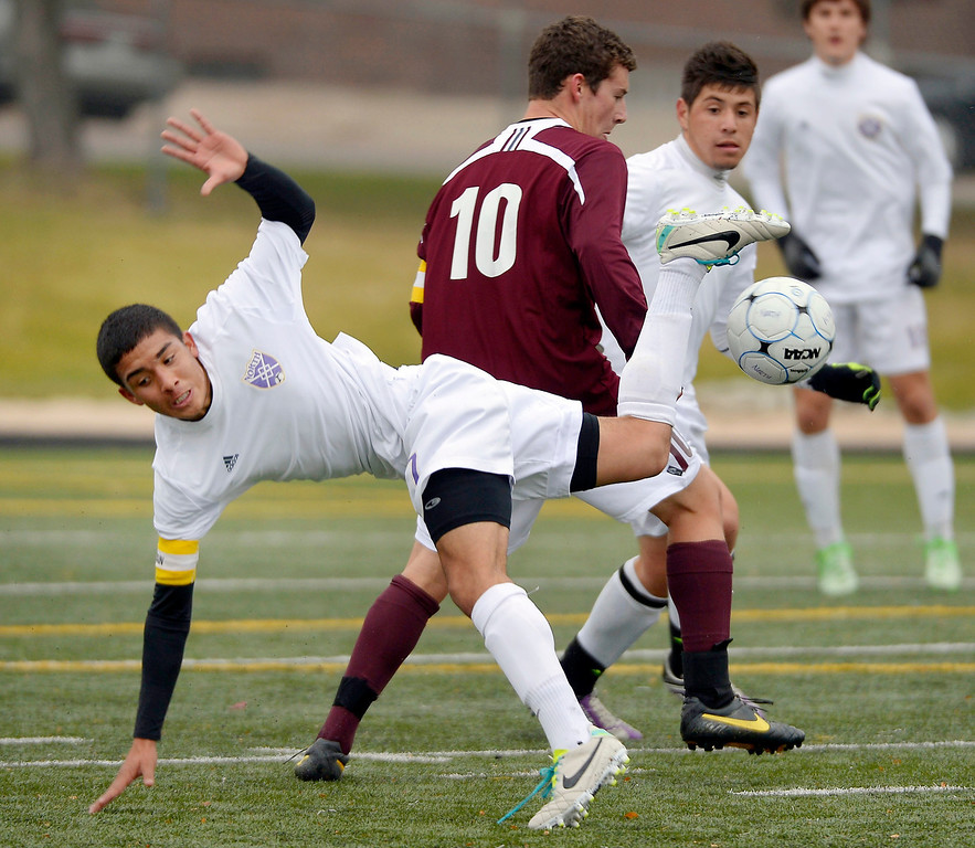 . Denver North\'s Misael Lopez (7) gets hit going after the ball by Golden\'s Jordan Cunningham (10) looks on during the first half. (Photo by John Leyba/The Denver Post)