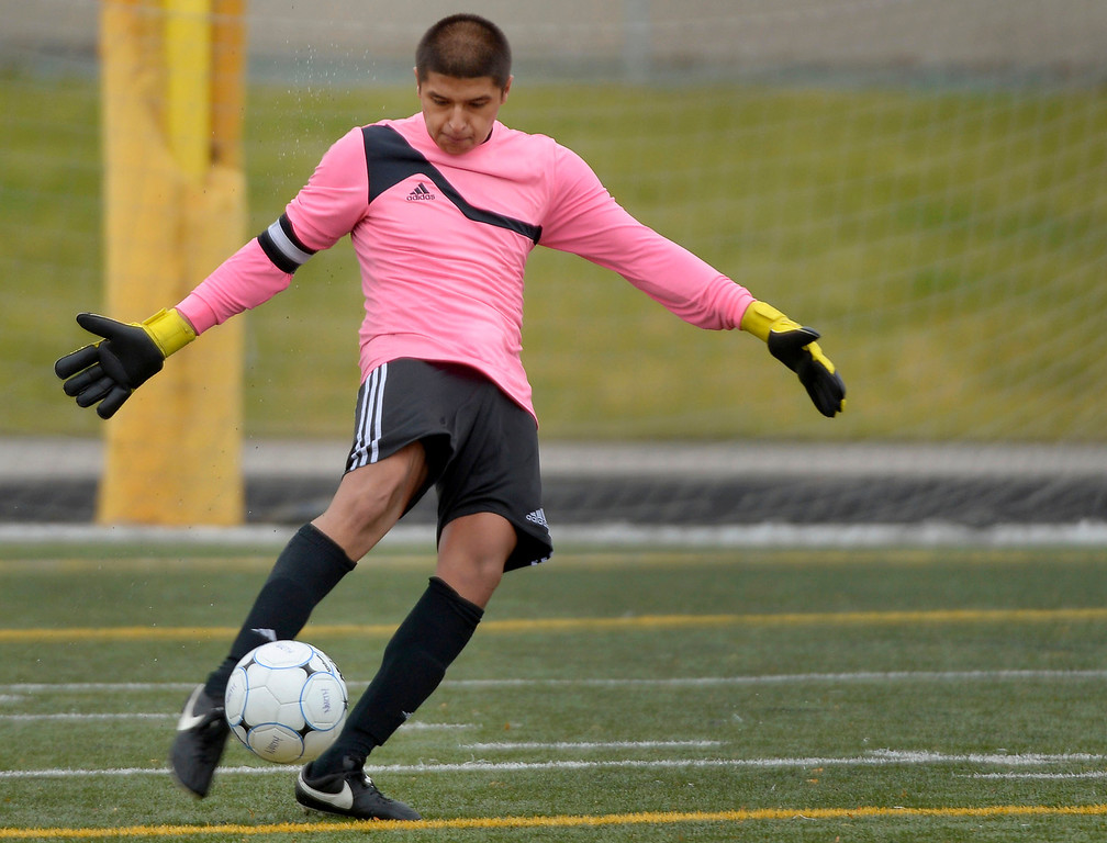 . Denver North GK Jorge Vega (1) punts the ball down field during the first half against Golden.    (Photo by John Leyba/The Denver Post)