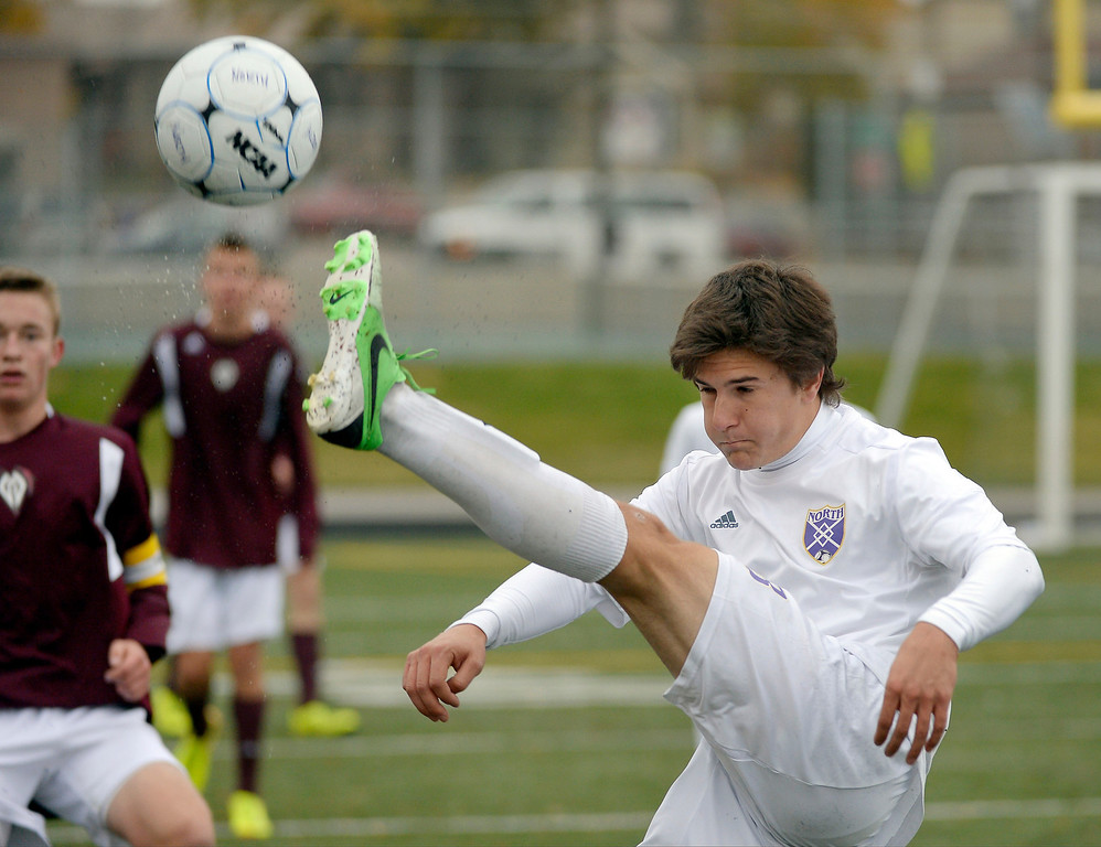. Denver North\'s Federico Brunner (18) kicks the ball back in to the North zone during the second half.  (Photo by John Leyba/The Denver Post)