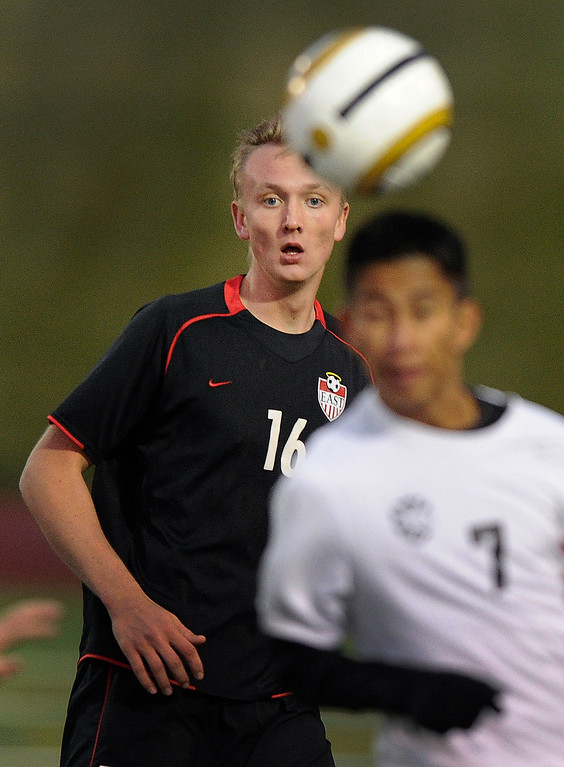 . East striker Harald Saeterdal (16) eyed the ball in the second half. Saeterdal, an exchange student from Norwary, got the golden-goal game winner Wednesday night, giving East a 2-1 win over Rangeview.    Photo By Karl Gehring/The Denver Post