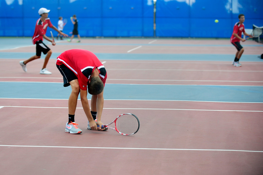 . Brock Dehaven or Fairview reacts to a missed shot during his No. 1  doubles match.  (Photo By Erin Hull/The Denver Post)