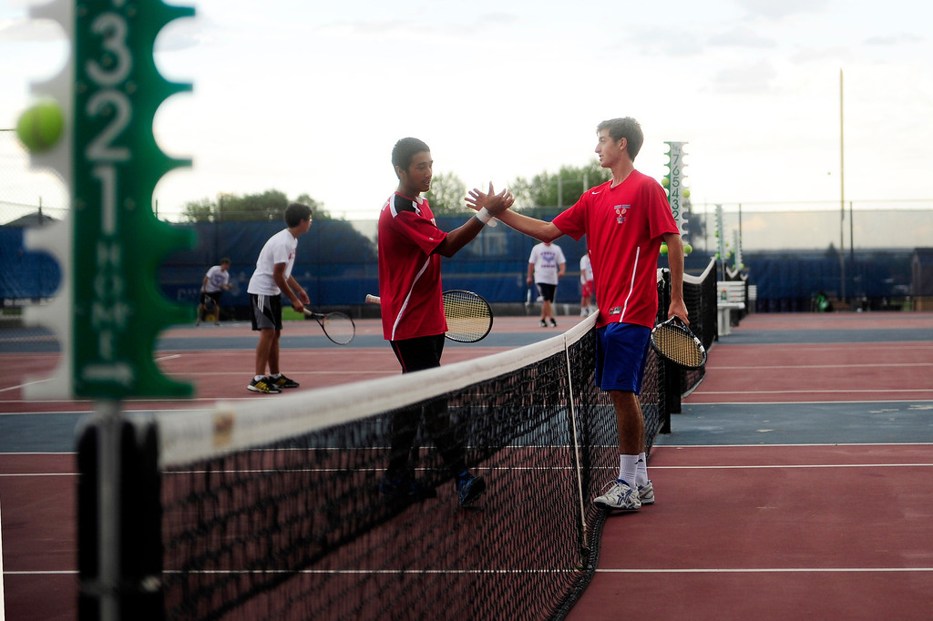 . Fairview\'s Ignatius Castelino and Cherry Creek\'s Zach Fryer shake hands after concluding their match in which Fryer was victorious.  (Photo By Erin Hull/The Denver Post)