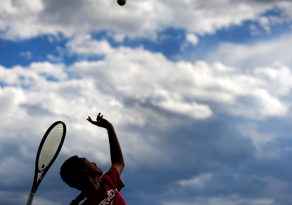 . Ignatius Castelino, of Fairview, serves to Cherry Creek\'s Zach Fryer during their No. 1 singles match on Tuesday night.   (Photo By Erin Hull/The Denver Post)