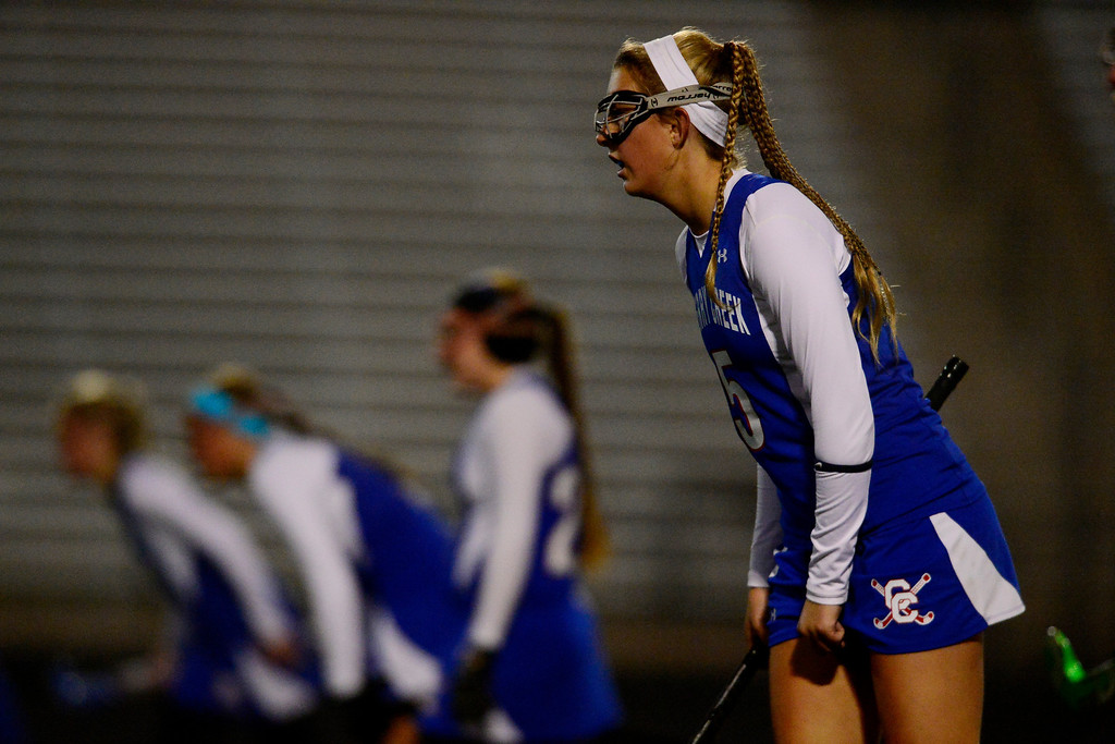 . Colorado Academy takes a shot as Cherry Creek\'s Nell List prepares to defend during the CHSAA state field hockey championship. Colorado Academy (17-0) capped a perfect season at All-City Stadium. (Photo by AAron Ontiveroz/The Denver Post)