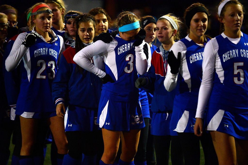. Colorado Academy accept their trophy as Cherry Creek players react during the CHSAA state field hockey championship. Colorado Academy (17-0) capped a perfect season at All-City Stadium. (Photo by AAron Ontiveroz/The Denver Post)