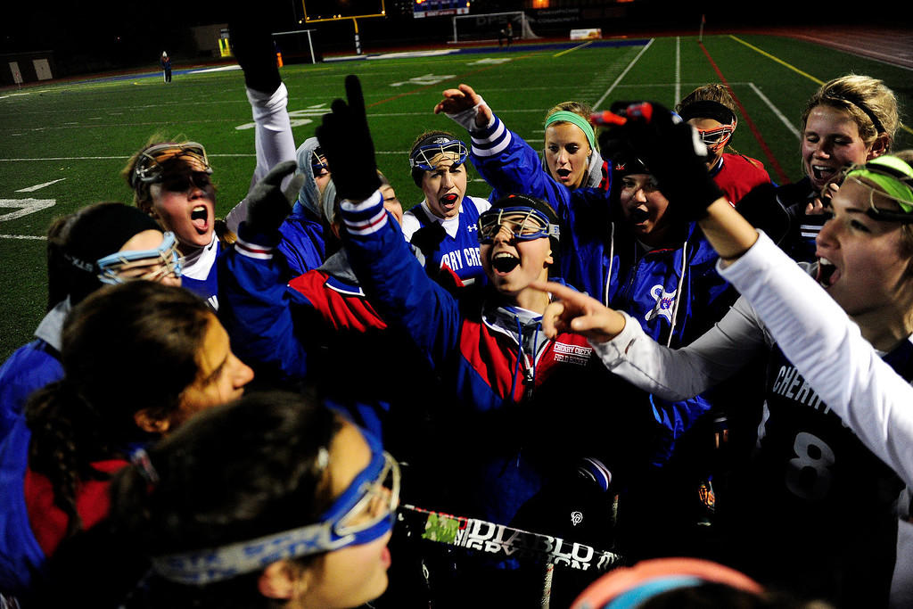. Cherry Creek players dance at halftime against Colorado Academy during the CHSAA state field hockey championship. Colorado Academy (17-0) capped a perfect season at All-City Stadium. (Photo by AAron Ontiveroz/The Denver Post)