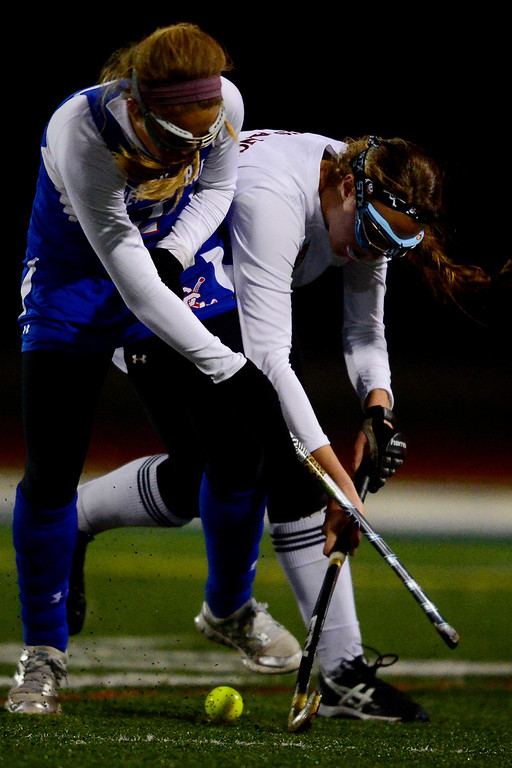 . Colorado Academy\'s Caroline Reisch controls the ball as Cherry Creek\'s Meredith Synott fights for control during the CHSAA state field hockey championship. Colorado Academy (17-0) capped a perfect season at All-City Stadium. (Photo by AAron Ontiveroz/The Denver Post)