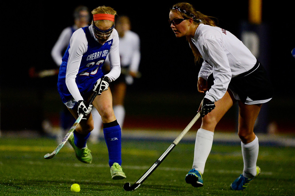 . Colorado Academy\'s Rachel Weeks defends as Cherry Creek\'s Blair Sisk controls the ball during the CHSAA state field hockey championship. Colorado Academy (17-0) capped a perfect season at All-City Stadium. (Photo by AAron Ontiveroz/The Denver Post)