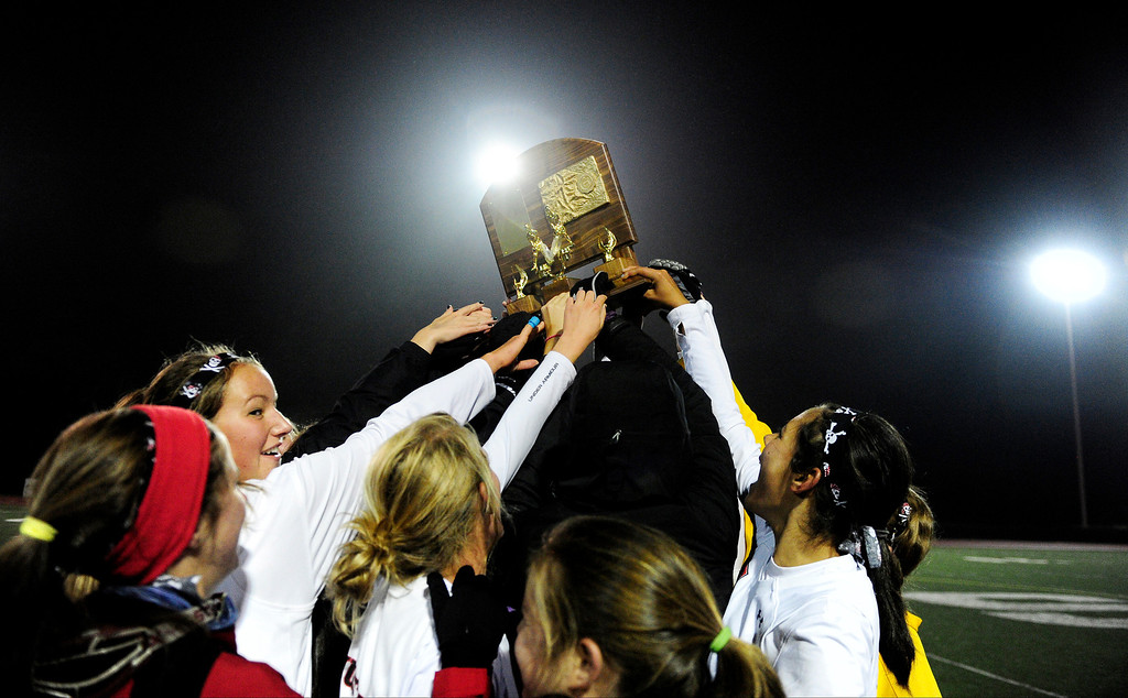 . Colorado Academy hoists their title trophy the CHSAA state field hockey championship. Colorado Academy (17-0) capped a perfect season at All-City Stadium. (Photo by AAron Ontiveroz/The Denver Post)