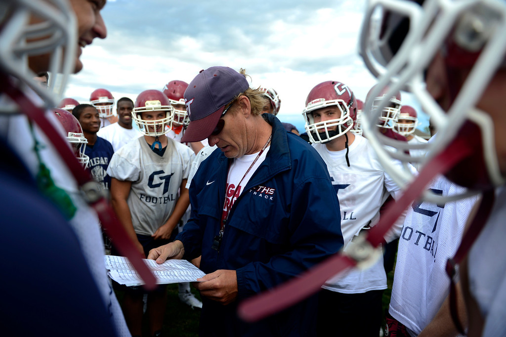 . Head coach Monte Thelen breaks down assignments for players during the first day of practice. Cherokee Trail lost to Valor Christian in last year\'s 5A state title game. (Photo by AAron Ontiveroz/The Denver Post)