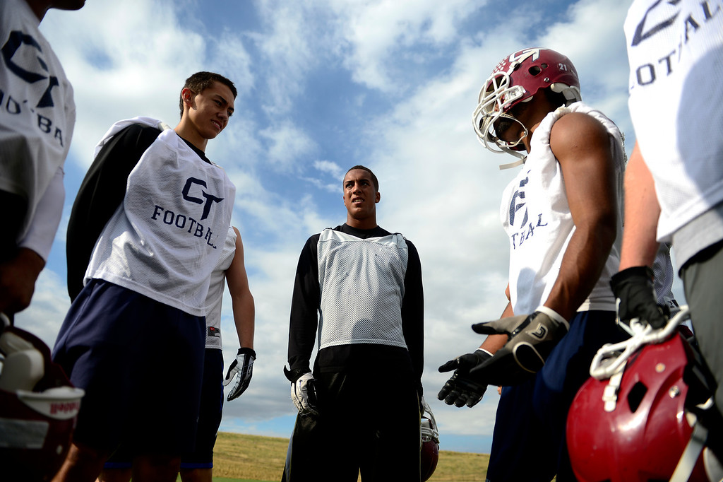 . Evan White (center) waits for drills to begin during the first day of practice. Cherokee Trail lost to Valor Christian in last year\'s 5A state title game. (Photo by AAron Ontiveroz/The Denver Post)