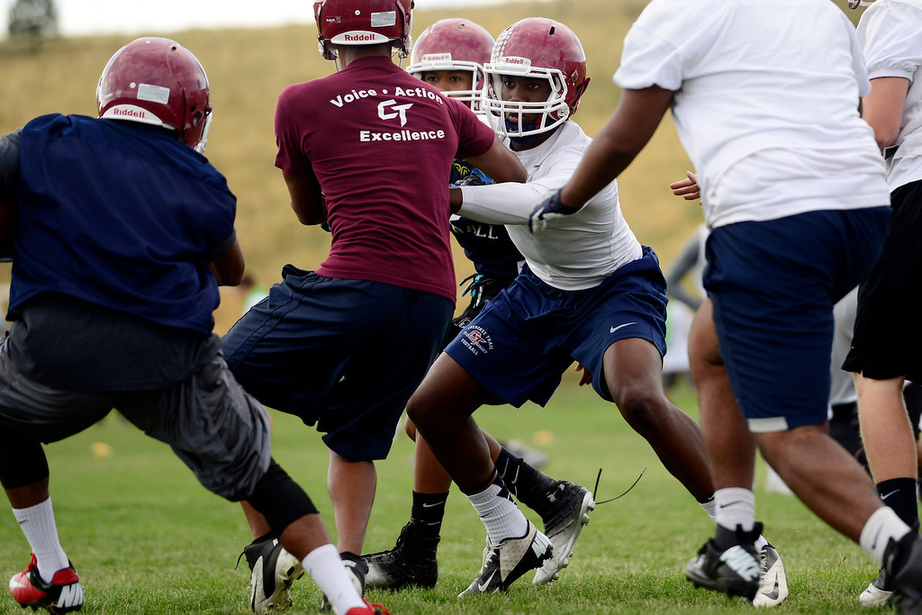 . Jacob Martin attempts to make a stop during the first day of practice. Cherokee Trail lost to Valor Christian in last year\'s 5A state title game. (Photo by AAron Ontiveroz/The Denver Post)
