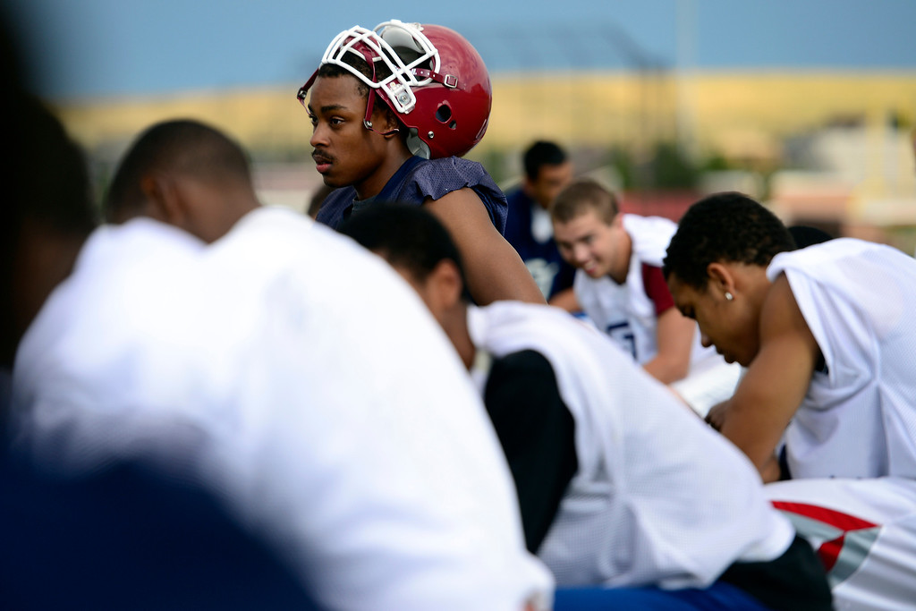 . Players kneel during the first day of practice. Cherokee Trail lost to Valor Christian in last year\'s 5A state title game. (Photo by AAron Ontiveroz/The Denver Post)
