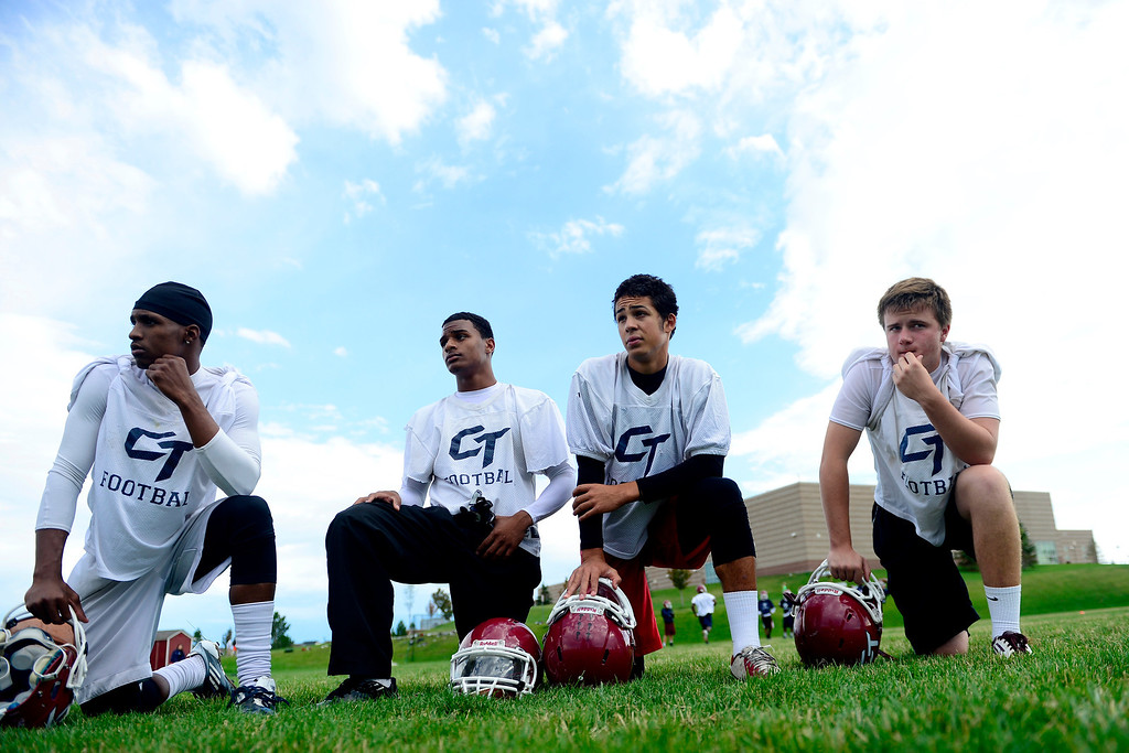 . Cherokee Trail players from left Jason Thompson, Dominique Grady, Aric Johnson and Blake Butler watch drills during the first day of practice. Cherokee Trail lost to Valor Christian in last year\'s 5A state title game. (Photo by AAron Ontiveroz/The Denver Post)
