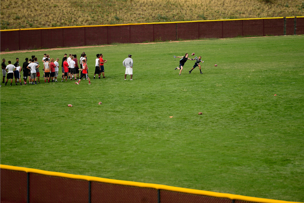 . Freshman run through drills on a baseball field during the first day of practice. Cherokee Trail lost to Valor Christian in last year\'s 5A state title game. (Photo by AAron Ontiveroz/The Denver Post)