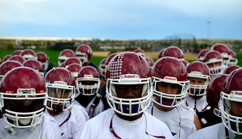 . The Cherokee Trail football team listens to head coach Monte Thelen during the first day of practice. Cherokee Trail lost to Valor Christian in last year\'s 5A state title game, and is preparing for the upcoming season. (Photo by AAron Ontiveroz/The Denver Post)