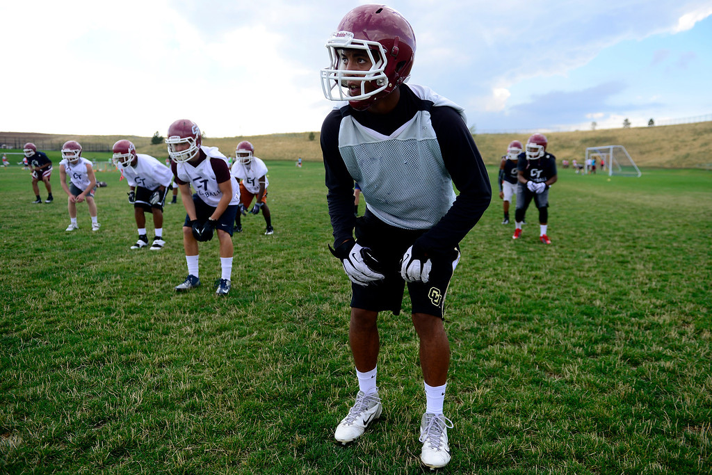 . Evan White runs through drills during the first day of practice. Cherokee Trail lost to Valor Christian in last year\'s 5A state title game. (Photo by AAron Ontiveroz/The Denver Post)