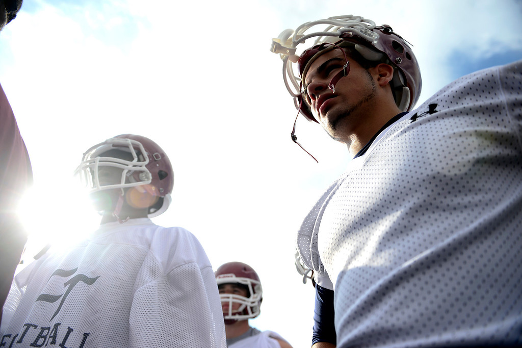 . Cherokee Trail players huddle during the first day of practice. Cherokee Trail lost to Valor Christian in last year\'s 5A state title game. (Photo by AAron Ontiveroz/The Denver Post)