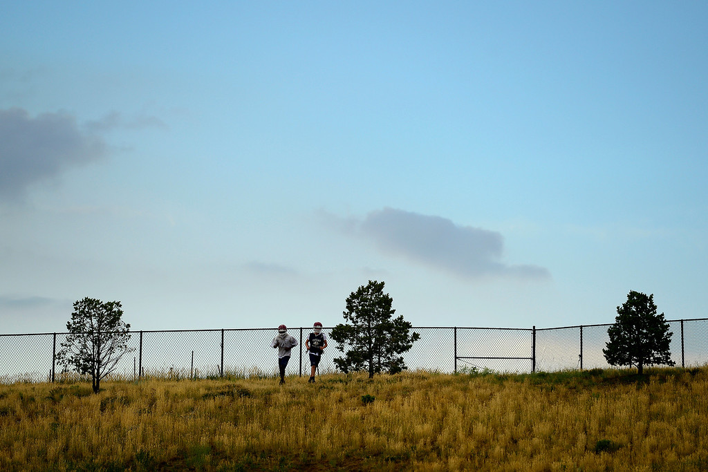 . Kyree Herron (left) and Logan McCord (right) run hills during the first day of practice. Cherokee Trail lost to Valor Christian in last year\'s 5A state title game. (Photo by AAron Ontiveroz/The Denver Post)