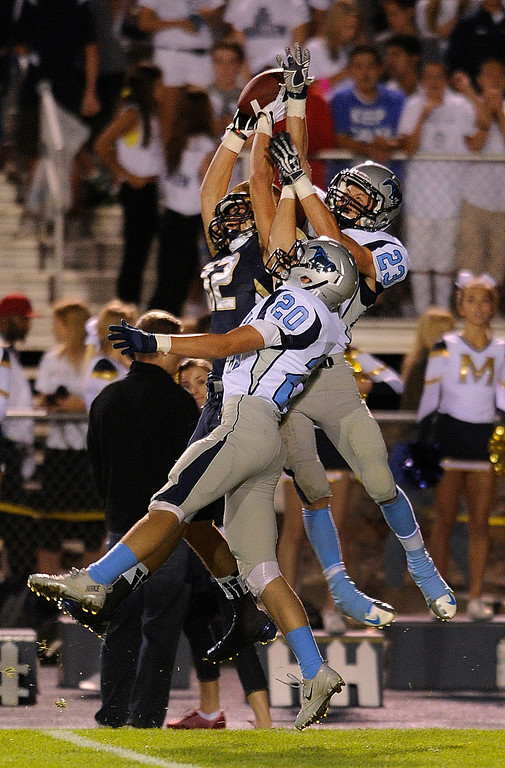 . DENVER, CO. - AUGUST 23: Ralston Valley defenders jack Martin (20 and Jesse Booton (23) broke up a pass intended for Mullen\'s Stephens Patrick in the third quarter. The Ralston Valley High School football team beat Mullen 43-0 Friday night, August 23, 2013. Photo By Karl Gehring/The Denver Post