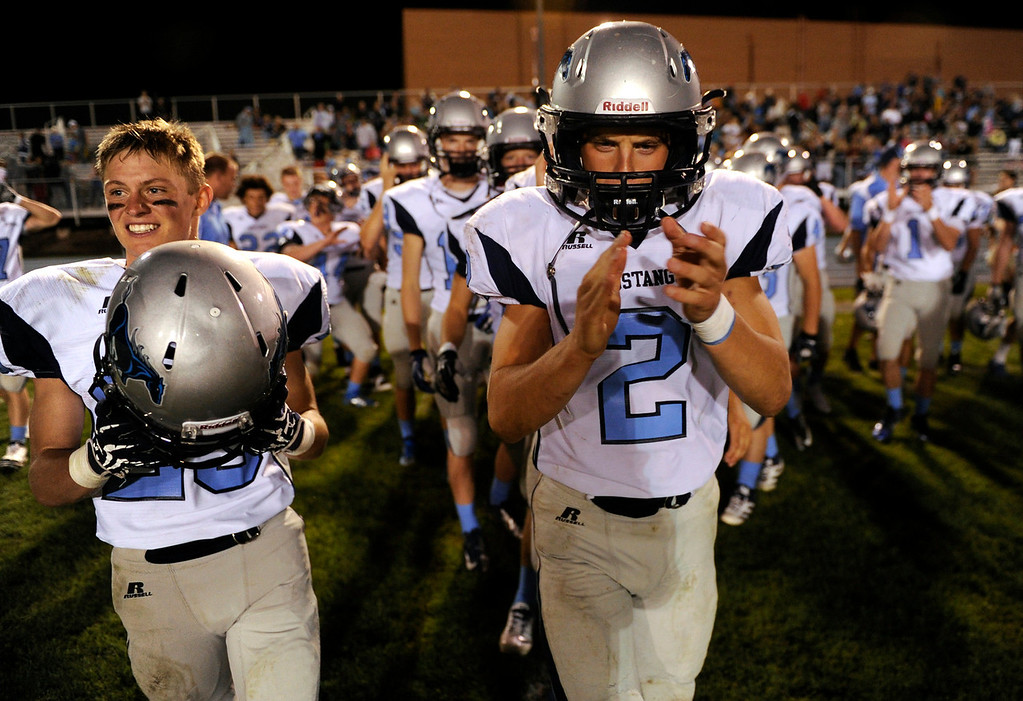 . DENVER, CO. - AUGUST 23: Jesse Booton, left, and Jon Baumann, right, led the team onto the field following the conclusion of the game. The Ralston Valley High School football team beat Mullen 43-0 Friday night, August 23, 2013. Photo By Karl Gehring/The Denver Post