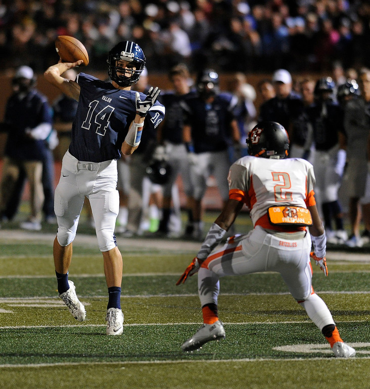 . DENVER, CO. - AUGUST 24: Valor freshman Dylan McCaffrey lofted a ball to the end zone in a bit of trickery that did not work in the first quarter. The Valor Christian High School football team hosted Central East Saturday night, August 24, 2013 in a nationally televised game. Photo By Karl Gehring/The Denver Post