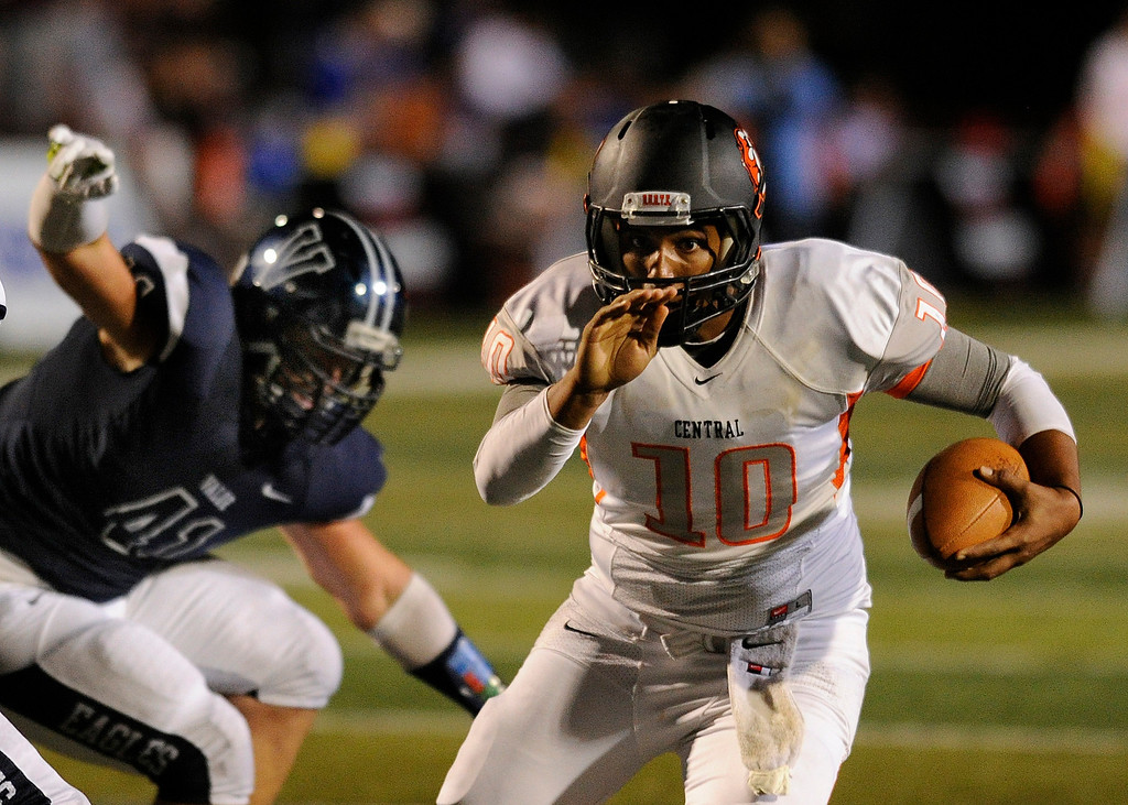 . DENVER, CO. - AUGUST 24: Grizzlies quarterback Eric Jimenez (10) found room to run for a touchdown in the third quarter. The Valor Christian High School football team hosted Central East Saturday night, August 24, 2013 in a nationally televised game. Photo By Karl Gehring/The Denver Post