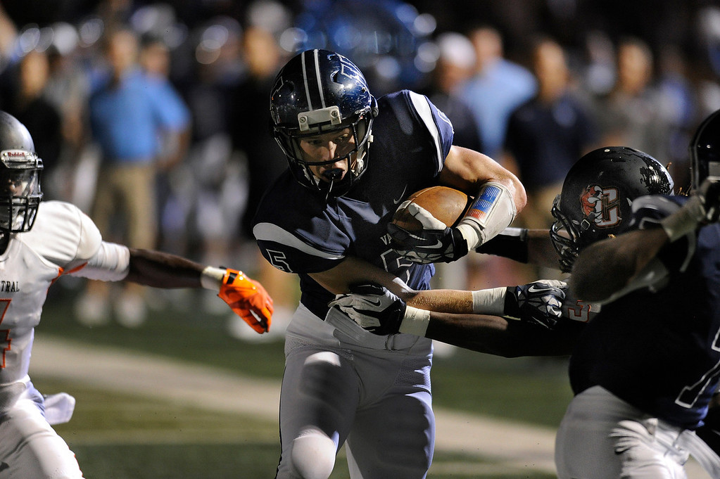 . DENVER, CO. - AUGUST 24: Valor running back Christian McCaffrey carried the ball in the first quarter. The Valor Christian High School football team hosted Central East Saturday night, August 24, 2013 in a nationally televised game. Photo By Karl Gehring/The Denver Post