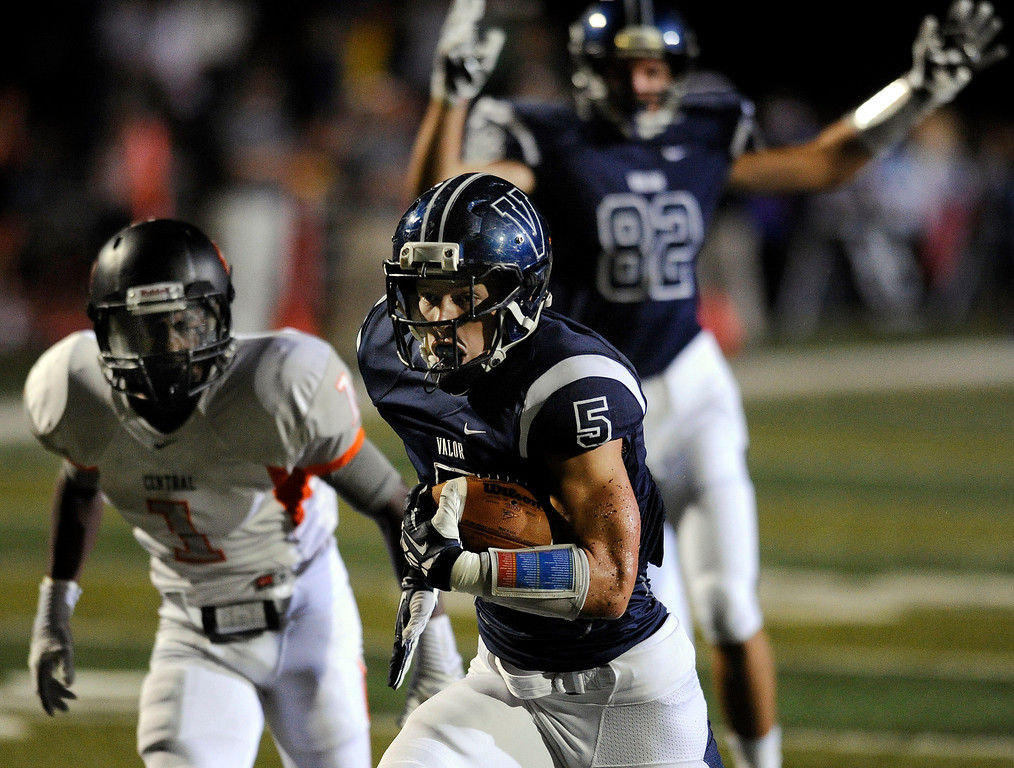 . DENVER, CO. - AUGUST 24: Eagles\' running back Christian McCaffrey (5) broke free for a first quarter touchdown Saturday night. The Valor Christian High School football team hosted Central East Saturday night, August 24, 2013 in a nationally televised game. Photo By Karl Gehring/The Denver Post