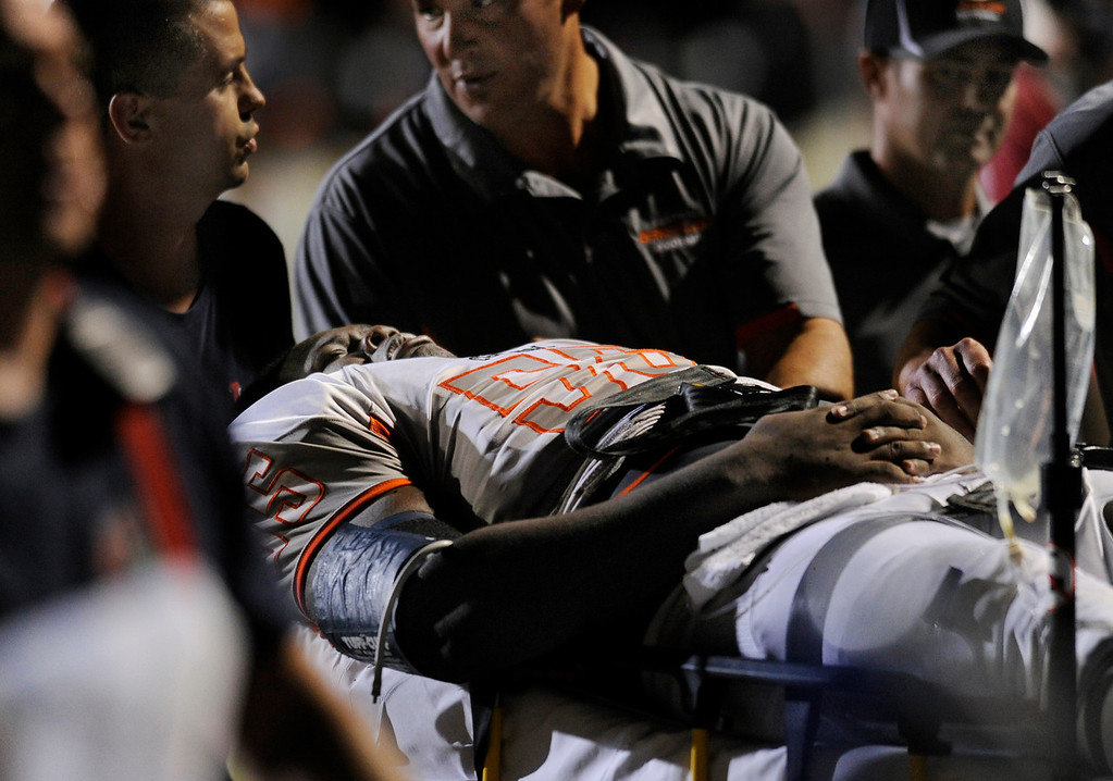 . DENVER, CO. - AUGUST 24: Grizzlies\' lineman Sharif Williams was carted him off the field by paramedics and coaching staff. It looked like Williams broke a bone in his leg on a play in the second quarter. The Valor Christian High School football team hosted Central East Saturday night, August 24, 2013 in a nationally televised game. Photo By Karl Gehring/The Denver Post
