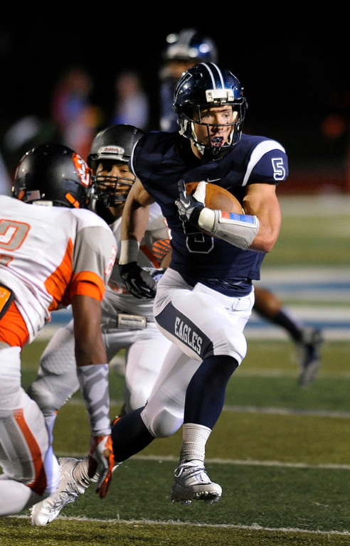 . DENVER, CO. - AUGUST 24: Eagles running back Christian McCaffrey made a cut in the first quarter. The Valor Christian High School football team hosted Central East Saturday night, August 24, 2013 in a nationally televised game. Photo By Karl Gehring/The Denver Post