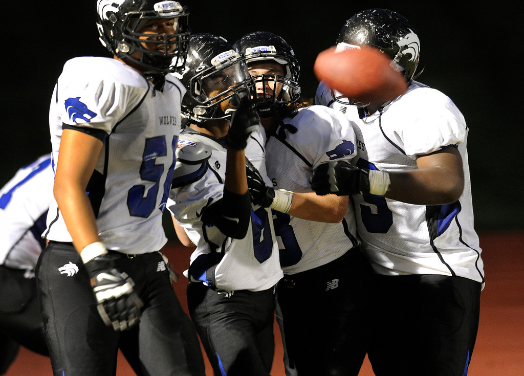 . THORNTON, CO. - AUGUST 29:  Grandview wide receiver Isaiah Lang (6) celebrated his touchdown catch with teammates in the second quarter. The Horizon High School football team hosted Grandview Thursday night, August 29, 2013.  Photo By Karl Gehring/The Denver Post