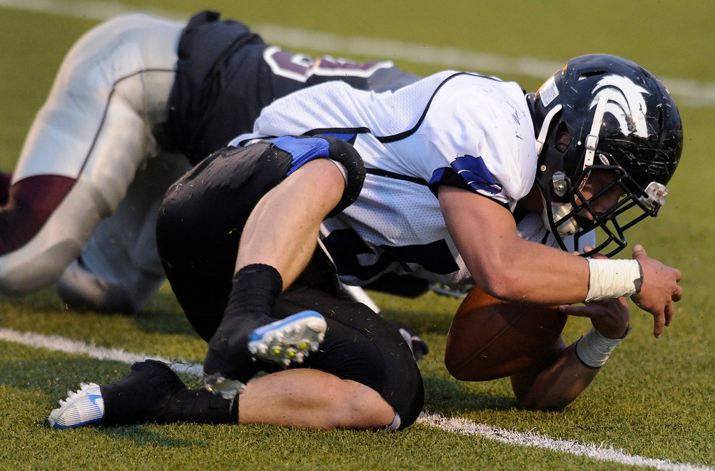 . Wolves\' junior Keifer Glau (5) recovered a fumble on a Horizon punt attempt in the first half. The Horizon High School football team hosted Grandview Thursday night, August 29, 2013.  Photo By Karl Gehring/The Denver Post