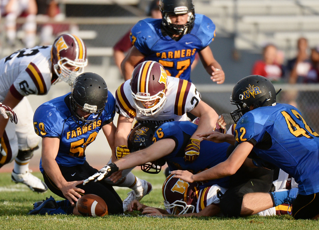 . LAKEWOOD, CO - August 30 : Tyler Wagner of Wheat Ridge High School (59) recovers the fumble by Wil Dressor of Windsor High School (22) in the first half of the game at Jefferson County Stadium. Lakewood, Colorado. August 30, 2013. (Photo by Hyoung Chang/The Denver Post)