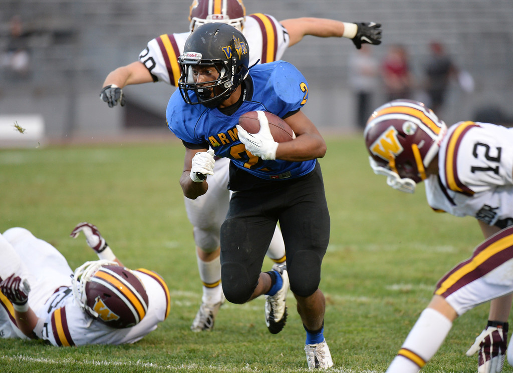 . LAKEWOOD, CO - August 30 : Averee Mason of Wheat Ridge High School (2) controls the ball against Windsor High School defense in the 2nd half of the game at Jefferson County Stadium. Lakewood, Colorado. August 30, 2013. Wheat Ridge won 31-22. (Photo by Hyoung Chang/The Denver Post)
