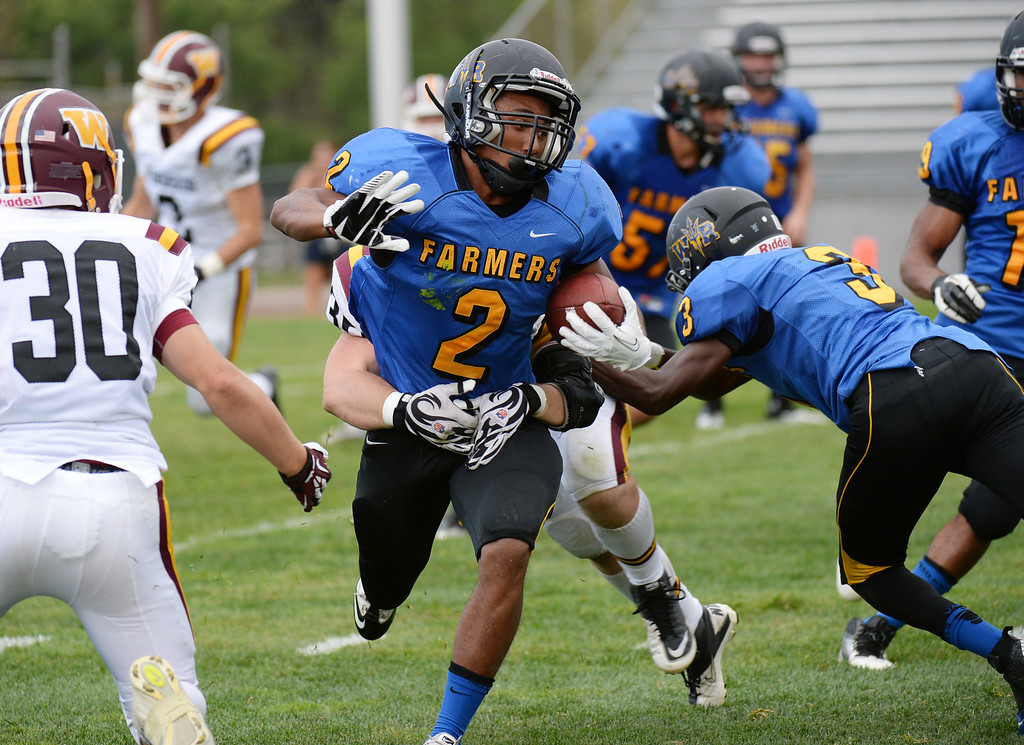 . LAKEWOOD, CO - August 30 : Averee Mason of Wheat Ridge High School controls the ball against Windsor High School defense in the 1st half of the game at Jefferson County Stadium. Lakewood, Colorado. August 30, 2013. (Photo by Hyoung Chang/The Denver Post)