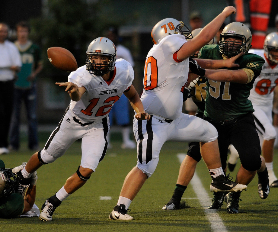 . HIGHLANDS RANCH, CO. - AUGUST 31:  Tigers\' quarterback Tyler Heinsma made a pitch to a back in the first half. The Mountain Vista High School football team hosted Grand Junction at Shea Stadium Saturday night, August 31, 2013. Photo By Karl Gehring/The Denver Post