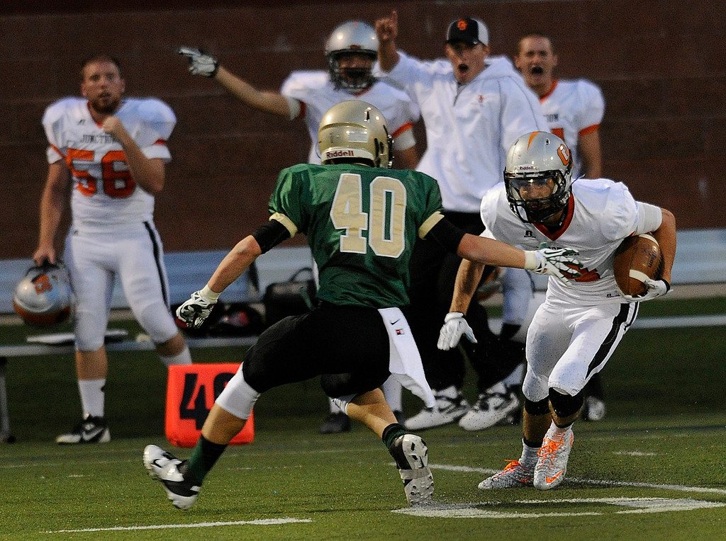 . HIGHLANDS RANCH, CO. - AUGUST 31:  Tigers\' wide receiver Jack Parsons (4) cut back inside Golden Eagles\' defender Kiel Brennan (40) in the first half. The Mountain Vista High School football team hosted Grand Junction at Shea Stadium Saturday night, August 31, 2013. Photo By Karl Gehring/The Denver Post