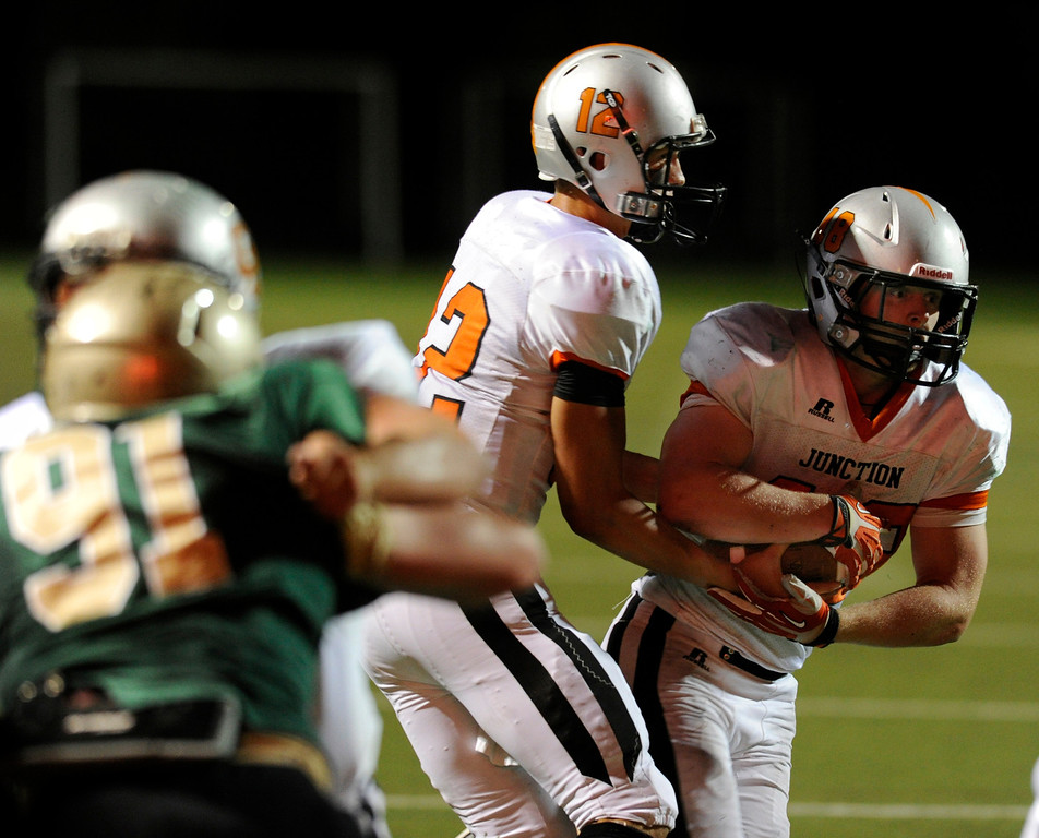 . HIGHLANDS RANCH, CO. - AUGUST 31:  Grand Junction running back Austin Lewis (48) got the call late in the fourth quarter. The Grand Junction Tigers defeated Mountain Vista 49-13 at Shea Stadium Saturday night, August 31, 2013. Photo By Karl Gehring/The Denver Post
